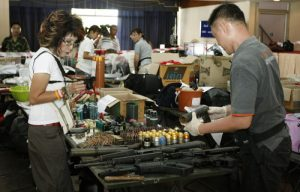 epa02168263 Thailand's Director of the Central Institute of Forensic Science, Pornthip Rojanasunand (L) and her team work on weapons seized before a press conference at the 11th Infantry Regiment in Bangkok, Thailand, 22 May 2010. Many weapons of war were arrested from the anti-government protest. After a week of mayhem devastated parts of Bangkok and left 53 people dead and 401 injured. The violence reached a peak 19 May, when 15 people were killed and 103 injured during and after an assault by army troops on the central Ratchaprasong district, where protesters calling for the dissolution of parliament and new elections had been camped on the streets and sidewalks since 3 April.  EPA/NARONG SANGNAK