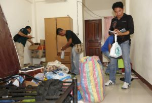 epa04904849 Thai plain clothed police officers search a rented room where believed to be linked with the arrested foreign suspect at Mimuna Garden Home apartment in Minburi district, on the outskirts of Bangkok, Thailand, 30 August 2015. A foreign suspect was arrested with fake Turkish passport who had in his possession bomb-making materials those were similar to the device used in the 17 August 2015 bombing at the Hindu Erawan Shrine that killed at least 20 people and injured hundreds. EPA/RUNGROJ YONGRIT