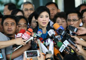 epaselect epa04906244 Former Thai prime minister Yingluck Shinawatra (C) speaks to members of the media as she leaves after her trial on criminal charges stemming from her government's rice price subsidy, at the Supreme Court's Criminal Division for Holders of Political Positions in Bangkok, Thailand, 31 August 2015. Yingluck appeared at the court for evidence examination in the rice price subsidy plan case during her government. The first woman prime minister of Thailand has already been impeached over the charges and has been banned from politics for five years. She called the decision politically motivated by her opponents. Corruption over the rice subsidy plan was one of the major reasons anti-government protesters used to call for her resignation. Yingluck's government was overthrown in a military coup one year ago after weeks of street protests.  EPA/NARONG SANGNAK