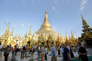 epa05014324 Foreign tourists flock the compound of the Shwedagon Pagoda in Yangon, Myanmar, 06 November 2015. Known also as the 'Great Dagon Pagoda', or 'Golden Pagoda' the gilded stupa is one of the landmark buildings and tourist magnets in Yangon. Some 4.5 to 5 million foreign tourists are expected to visit Myanmar in 2015 and aimed the target to be double with 10 million visitors in 2016 after the general elections. Myanmar had 3.05 million tourists visiting the country in 2014, according to Ministry of Hotels and Tourism.  EPA/RUNGROJ YONGRIT